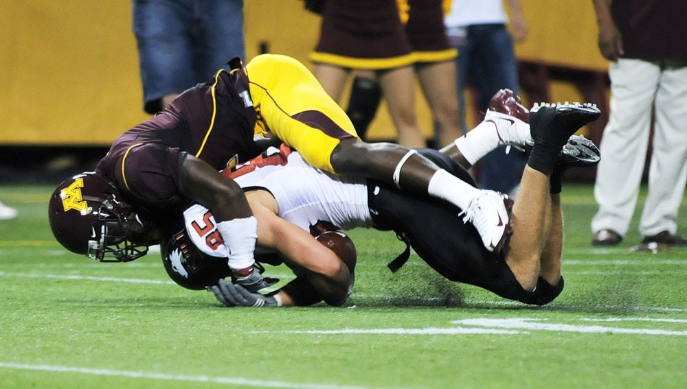 Junior safety Tramaine Brock wraps up a Northern Illinois ball carrier last Saturday at the Metrodome in the Gophers' 31-27 win.