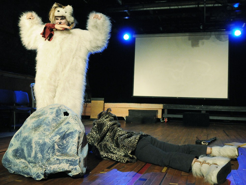 "Mina Leierwood, dressed as a polar bear, bites the hand off of a faux Gov. Sarah Palin during the Bedlam Theatre's production of ""Because We Still Live Here"" last Thursday night. ""Because We Still Live Here"" is a series of 'creative reflections' documenting the experiences of various community members during the RNC."