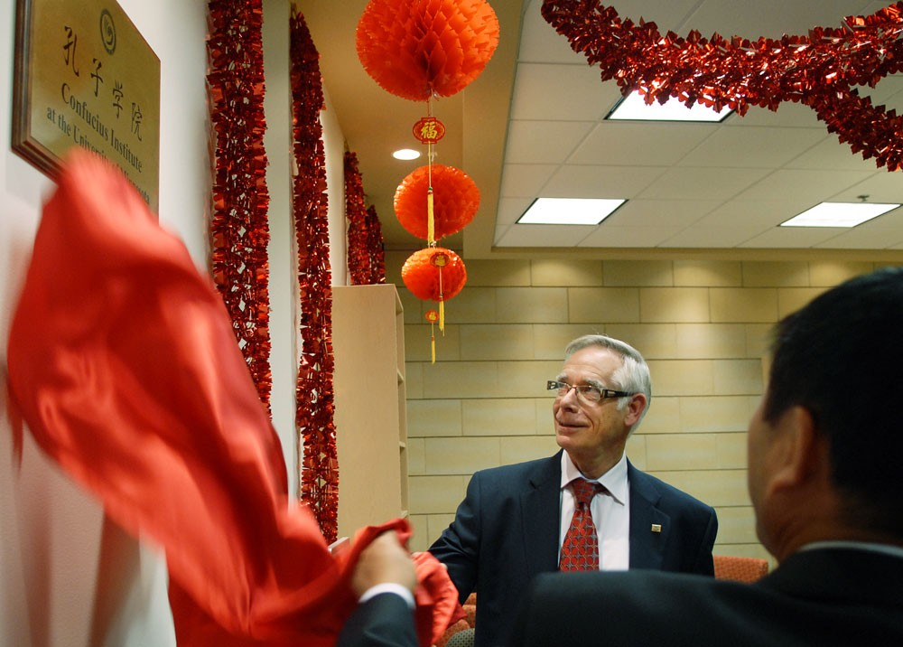 University President Bob Bruininks helps unveil a plaque Friday at the opening celebration of the Confucius Institute at the University of Minnesota. The institute aims to promote the study of Chinese language and culture in Minnesota.