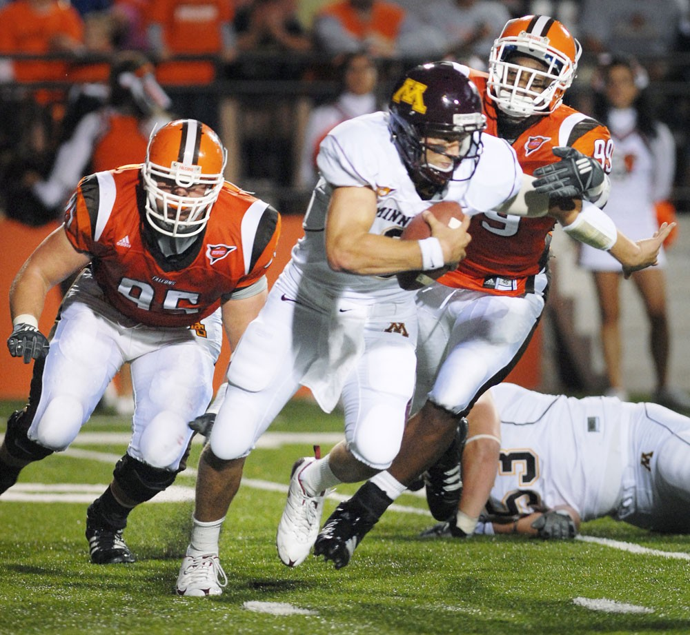 Sophomore quarterback Adam Weber does his best to escape a pair of Bowling Green foes in Saturday's 42-17 win over the Falcons Saturday night.