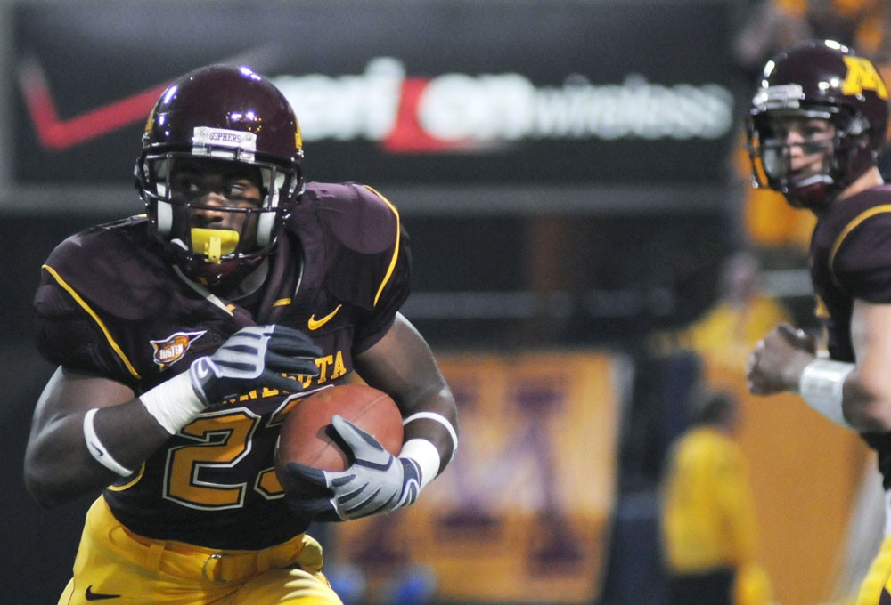 Freshman DeLeon Eskridge runs the ball last weekend against Montana State. Eskridge, Shady Salamon and Jay Thomas are competing for the starting running back position after the Gophers lost Duane Bennett for the season to injury.