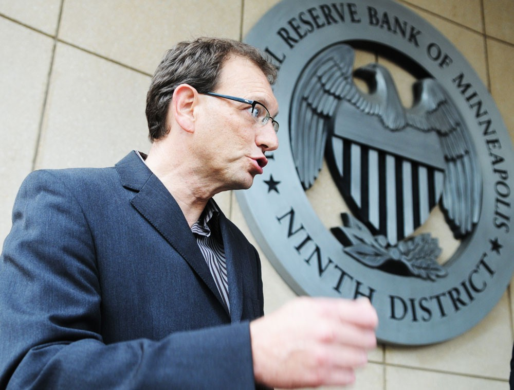 University law professor Prentiss Cox speaks at the Federal Reserve Bank of Minneapolis on Thursday during a demonstration to protest Congress's proposed bailout for financial firms.