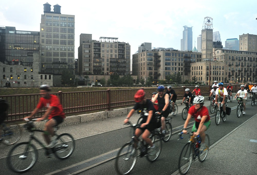 Minneapolis Mayor R.T. Rybak leads the second leg of the More to Tri modified triathlon Tuesday on the Stone Arch Bridge. Everyone, including delegates and visitors here for the Republican National Convention, was invited to participate.