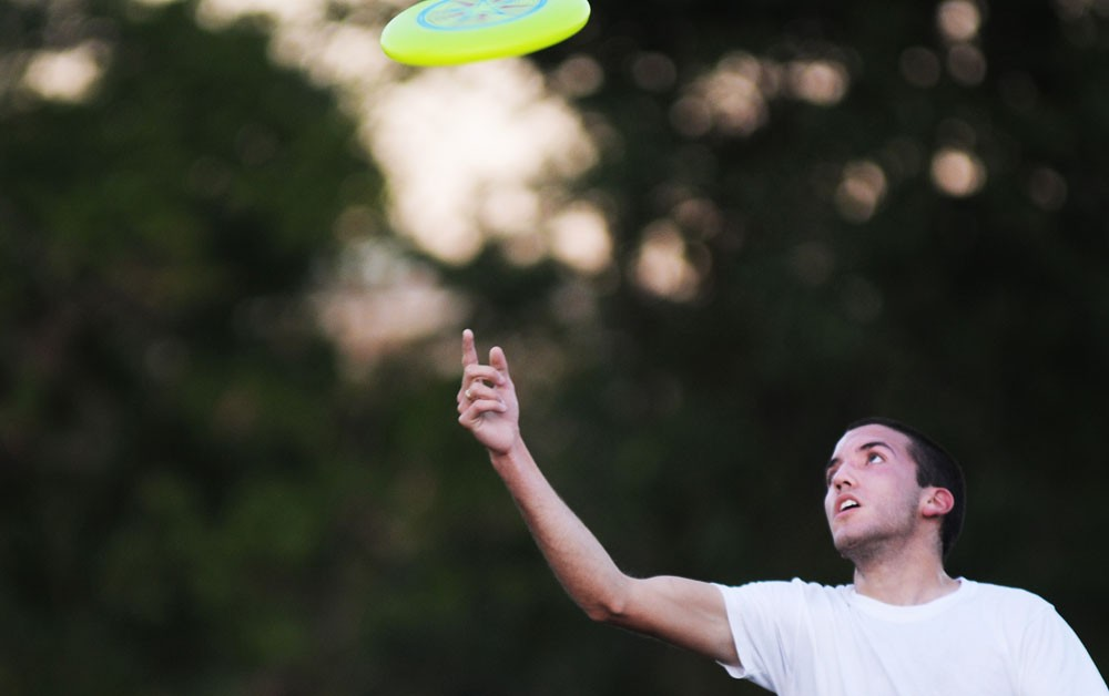 University supply management sophomore Nick Caretta plays Frisbee on Tuesday at the West Bank Fields. Caretta is involved in both intramural soccer and ultimate Frisbee.