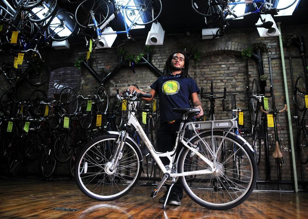 Sean Eddins models a Schwinn motor bike at the Varsity Bike Shop in Dinkytown on Sunday. Motor bikes are becoming an increasingly popular trend on campus.