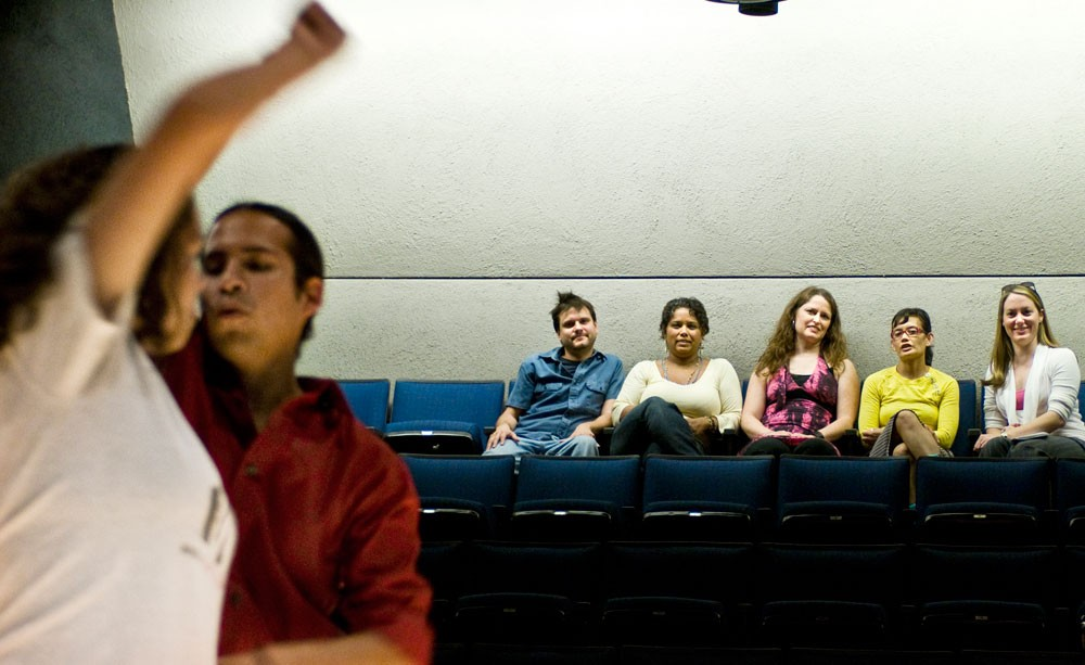"""Dancers rehearse before the staged reading of """"Make it to the Dance Floor: A Salsa Guide for Women (Based on Actual Experiences),"""" while playwright Cindy Garcia and associates watch Monday in the Rarig Center. The writing describes noticed behavior and personal stories of feeling unaccepted in the club."""