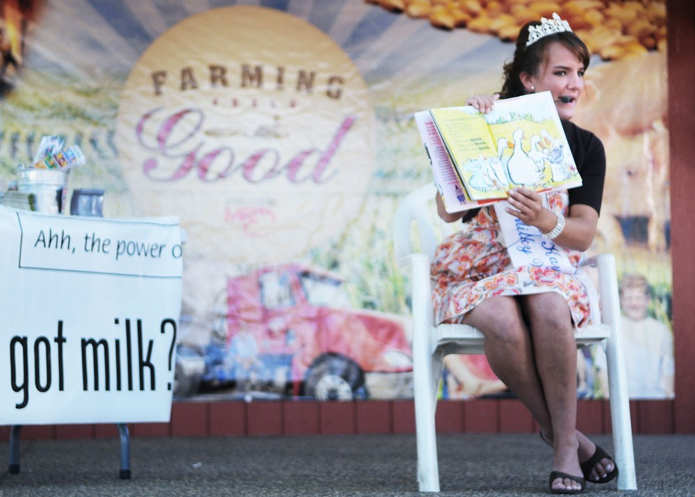 "Applied Economics junior Kristy Mussman, the 2008-2009 ""Princess Kay of the Milky Way,"" reads ""Click, Clack, Moo: Cows That Type"" to children and families at the State Fair Friday. ""[Interacting with children] is probably my favorite part of being Princess Kay,"" Mussman said."