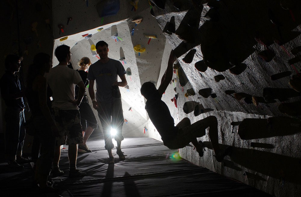 Climbers attend the grand re-opening of the climbing/bouldering wall Friday at the St. Paul Gym. The wall, torn down last spring, now has more than 900 sq. feet of climbing area.