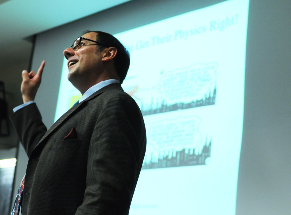 University physics professor James Kakalios speaks about the connections between superheroes and material science Wednesday at the Tate Laboratory of Physics.