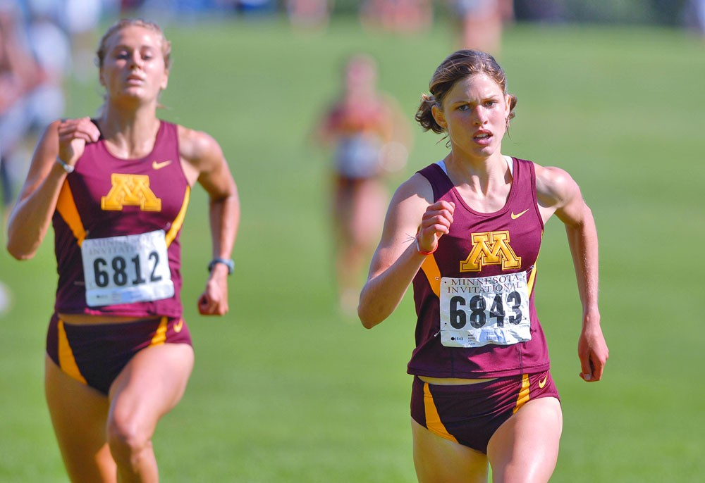 Juniors Elizabeth Yetzer, left, and Heather Dorniden run together at the Oz Memorial last season. Coach Gary Wilson said he continues to stress a team oriented attitude in his program.