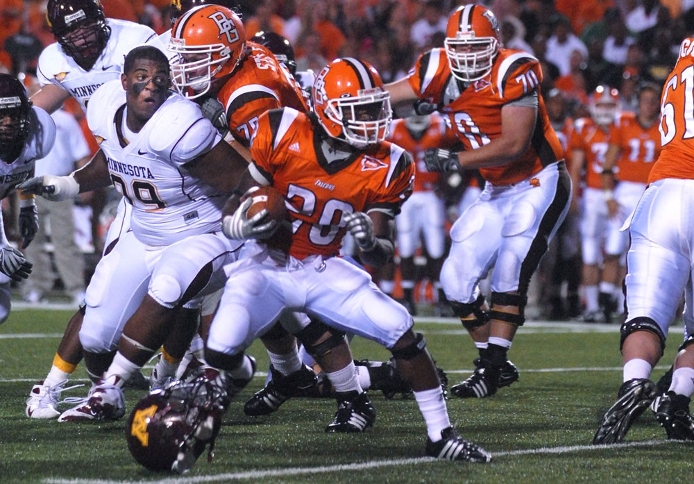 Junior defensive tackle Garrett Brown chases down Bowling Green running back Willie Geter during Saturday's win in Ohio.