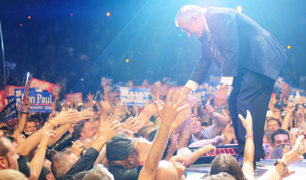 Ron Paul shakes the hands of supporters Tuesday at the end of his hour long speech at the Target Center.