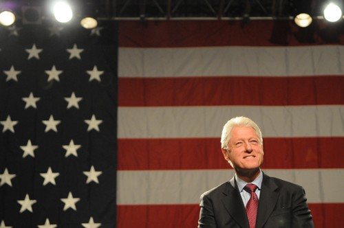 Former President Bill Clinton speaks at a rally Thursday night at the Minneapolis Convention Center.