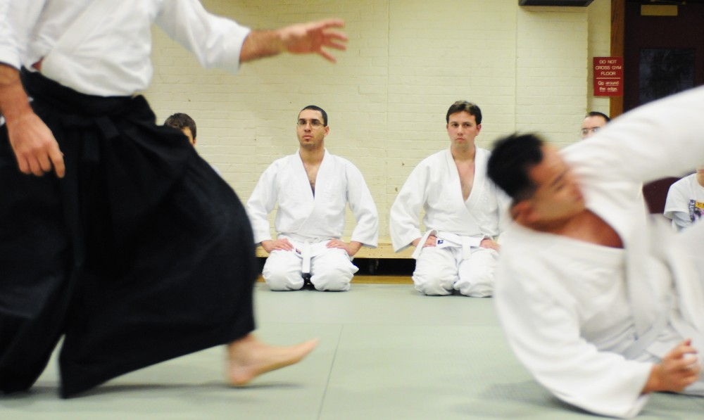 Sensei Patrick Riley, left, and Luan Nguyen practice Aikido at the Armory on Tuesday. Aikido is a unique kind of martial arts that emphasizes control through the use of pressure points, throws and wrist locks.
