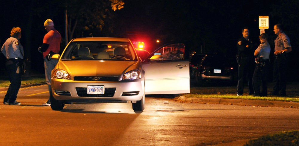 Police officers search a car involved in a chase that ended in the intersection of Sixth Avenue Southeast and Fifth Street Southeast late Tuesday.