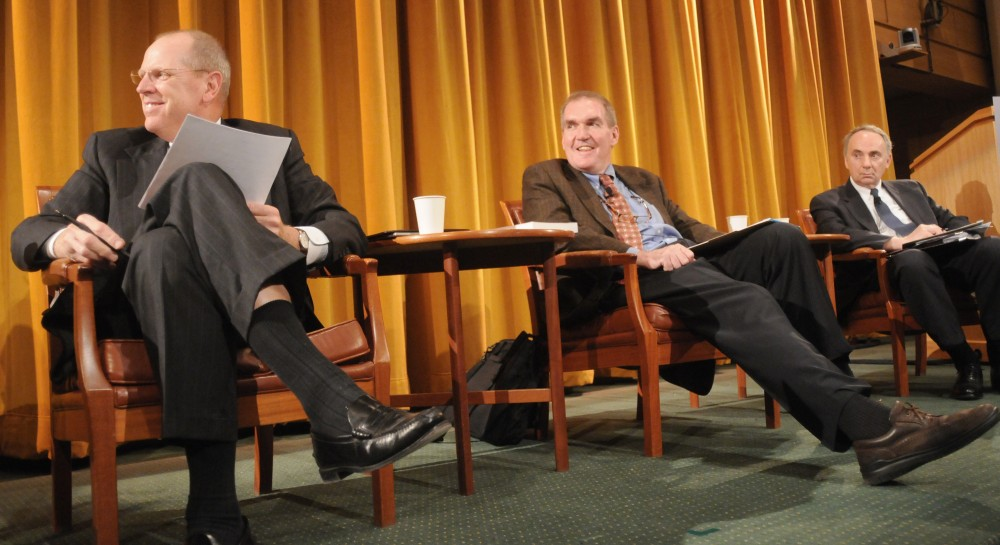 Moderator Jay Kiedrowski, left, University economics professor Tim Kehoe, middle, and state economist Thomas Stinson discuss the current financial crisis at a panel discussion at the Cowles Auditorium in the Humphrey Institute of Public Affairs on Tuesday.