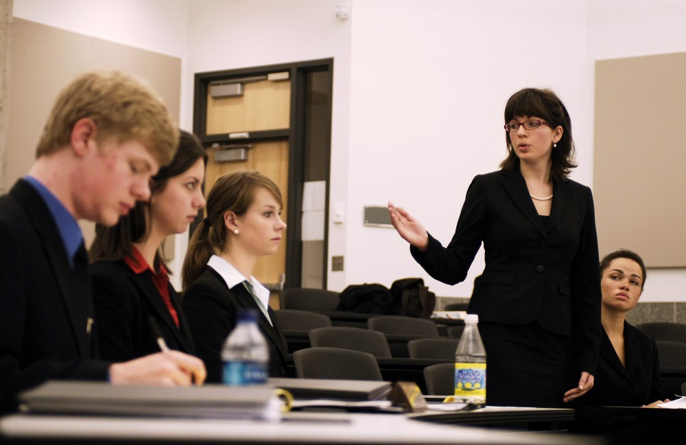 Macalester College senior Marina Duvall gives her closing arguments at the Mock Trial Invitational at Hanson Hall on Sunday. The first annual event featured teams from four different states across the Midwest.