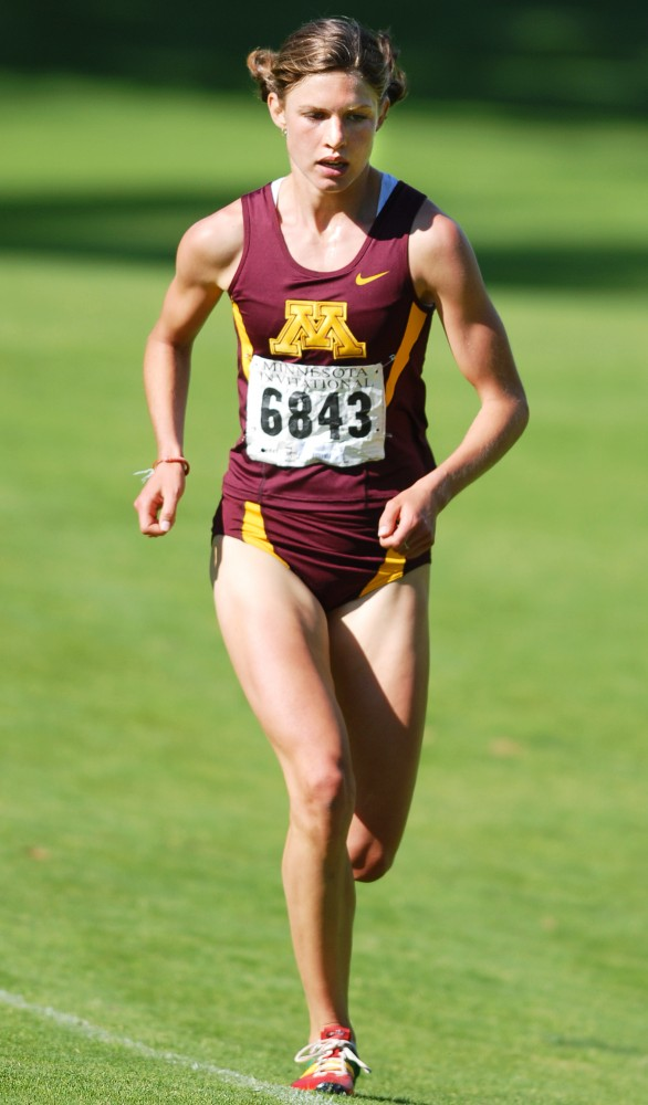 Women's Cross Country Team runs the OZ invitational on the Les Bolstad Golf Course