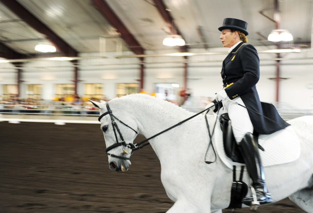 Olympian equine competitor Becky Holder and horse Courageous Comet perform their Olympic routine Saturday afternoon at Leatherdale Equine Center. Holder is a Minnesota native and gave a talk about her Olympic experience.