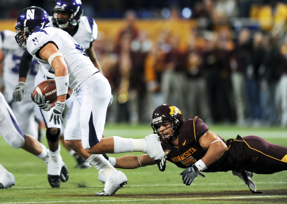Northwestern's Brendan Smith is just out of reach of junior receiver Eric Decker, as Smith picked off an Adam Weber pass at the 48-yard line in the fourth quarter. Smith returned the interception for a touchdown with 12 seconds to go in the game, sealing the upset.