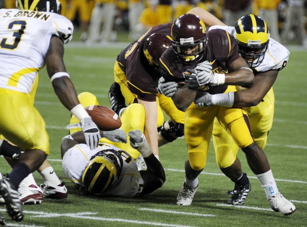 Freshman Running back DeLeon Eskridge is popped by a Michigan defender as the ball is jarred lose. The Gophers would recover, but the play was representative of an overall poor offensive performance.