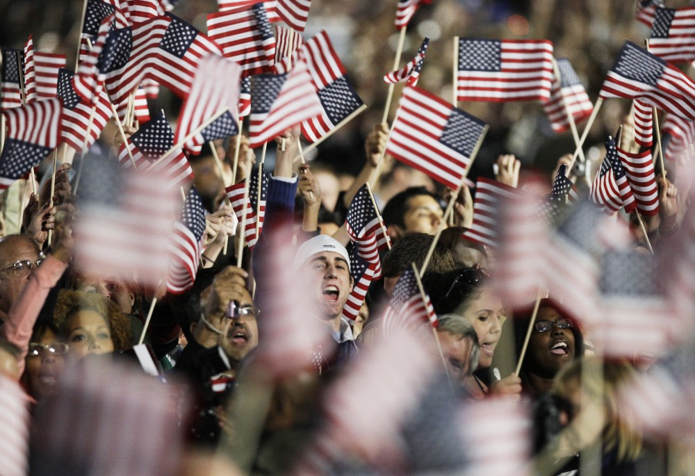 Supporters cheer as they hear results from television that President-elect Barack Obama has been elected President of the United States at Grant Park in Chicago, Tuesday night, Nov. 4, 2008.  (AP Photo/M. Spencer Green)