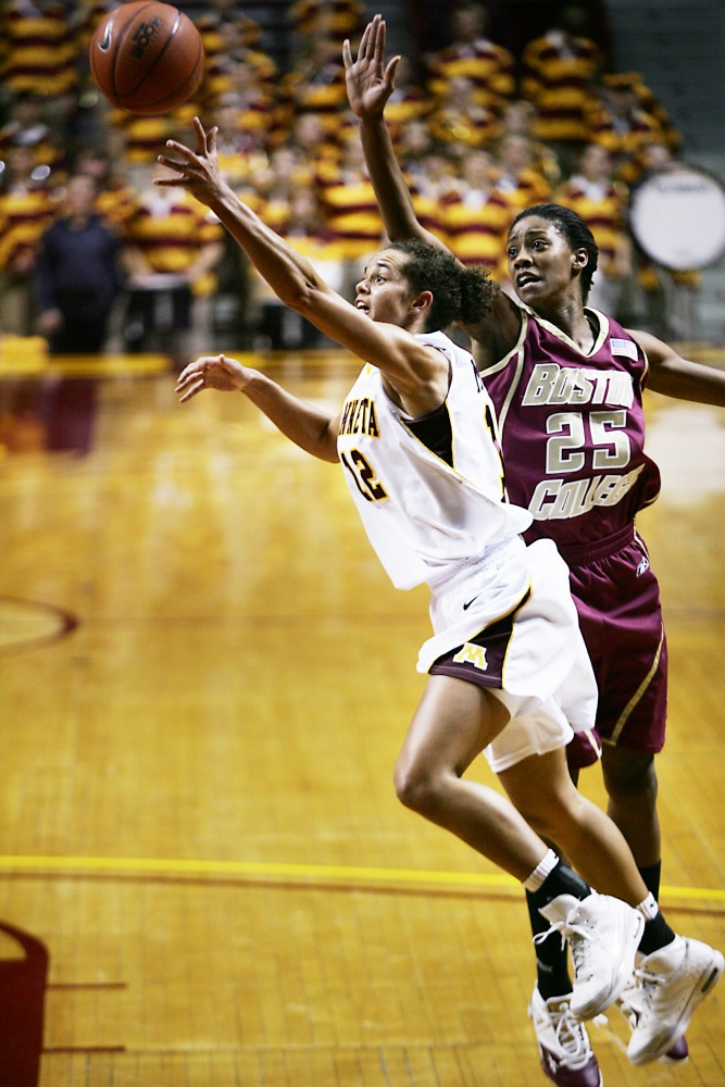 Junior guard Brittany McCoy scrambles for the ball during Minnesota's win over Boston College in the Gophers' Big Ten/ACC Challenge matchup.
