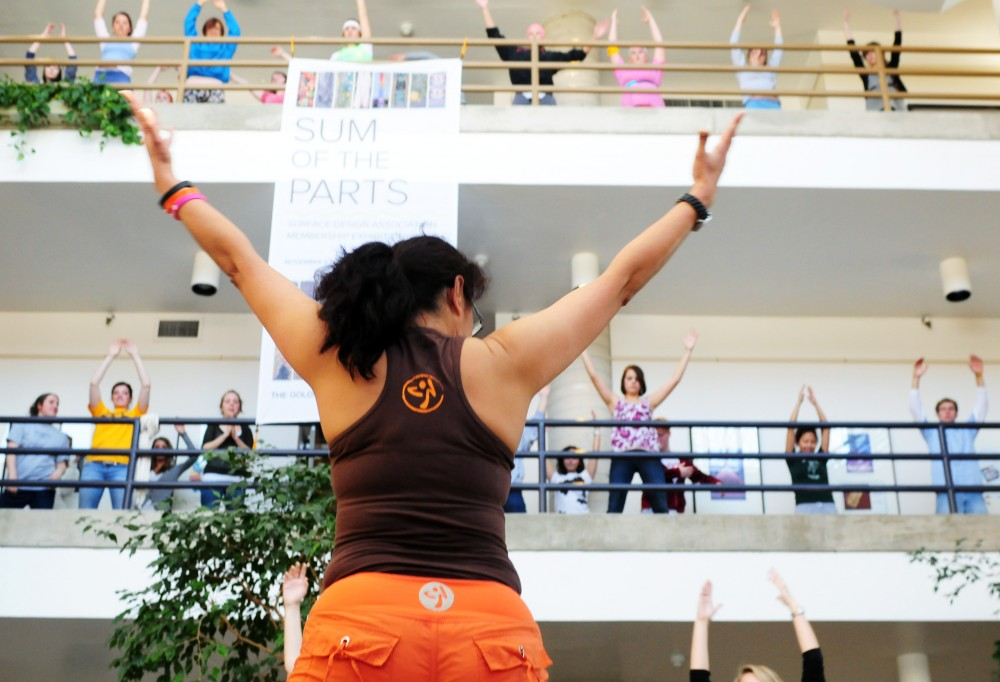 Naseema Shidi leads a creative problem solving class in Zumba dancing Wednesday in the McNeal Hall atrium. Zumba dancing is an exercise program based on the integration of Latin music and dance with traditional aerobics.