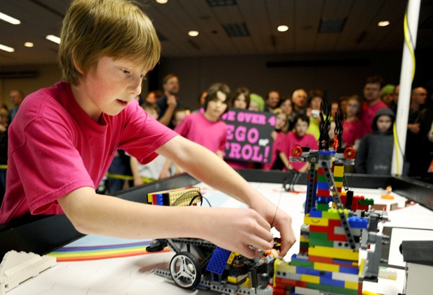 Robbinsdale Spanish Immersion School 5th grader Garret Williams fixes the robot for his team, the Lego Patrol, during their final run at the First Lego League State Championship on Saturday at the Continuing Education building on the St. Paul campus. The competition exposes students to science and technology with environmental emphasis with this year's theme Climate Connection.