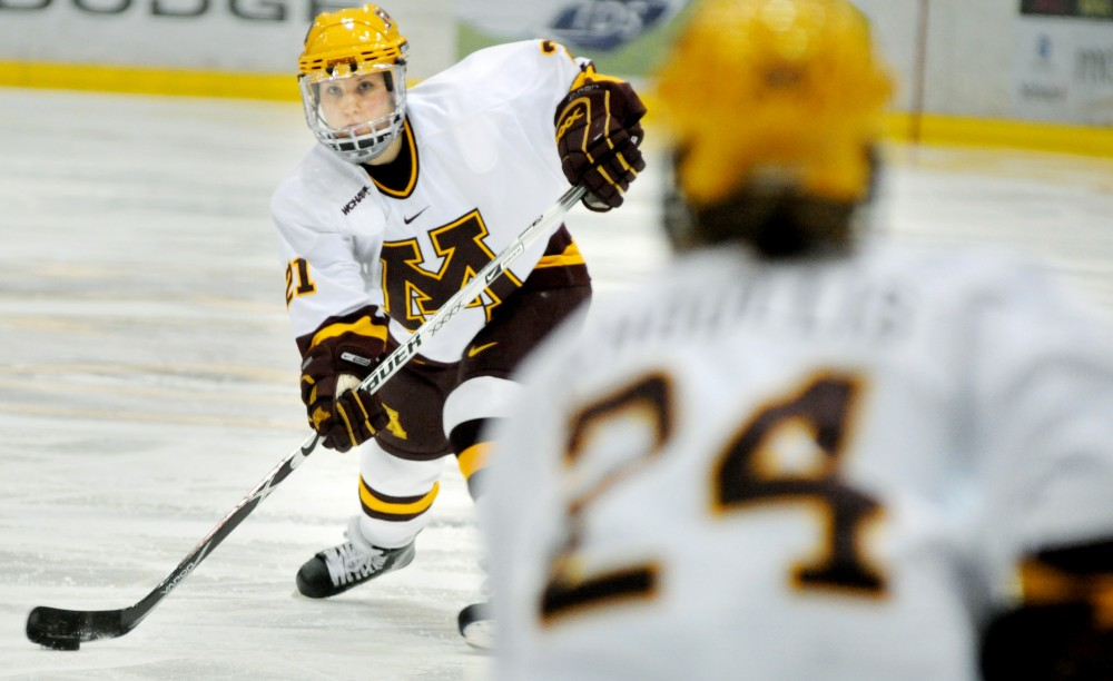 Freshman forward Monique Lamoureux  looks to an open sophomore Jen Schoullis  during one of the Gophers' two wins over Bemidji State over the weekend.