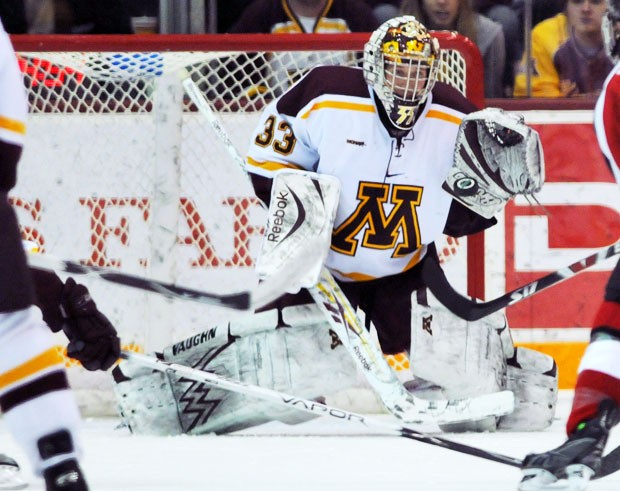 Sophomore goaltender Alex Kangas watched his first game of the season from the bench Friday night as the Gophers tied 2-2.