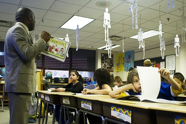 "Assistant vice president for Equity and Diversity Rickey Hall, left, reads ""I know I can"" to third grade students at the Sullivan School on Wednesday as part of a college awareness day taking place in Minneapolis Public Schools."