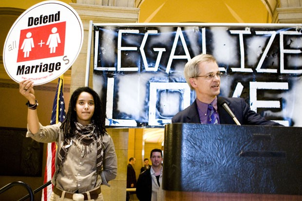 """Senator John Marty (right) and member of OutFront Minnesota Kelly Louis (left) speak at a rally in support of """"Freedom to Marry Week"""" at the State Capitol on Thursday. Senator Marty presented the Marriage and Family Act to the Minnesota state Senate that would make marriage laws gender-neutral in the state of Minnesota."""