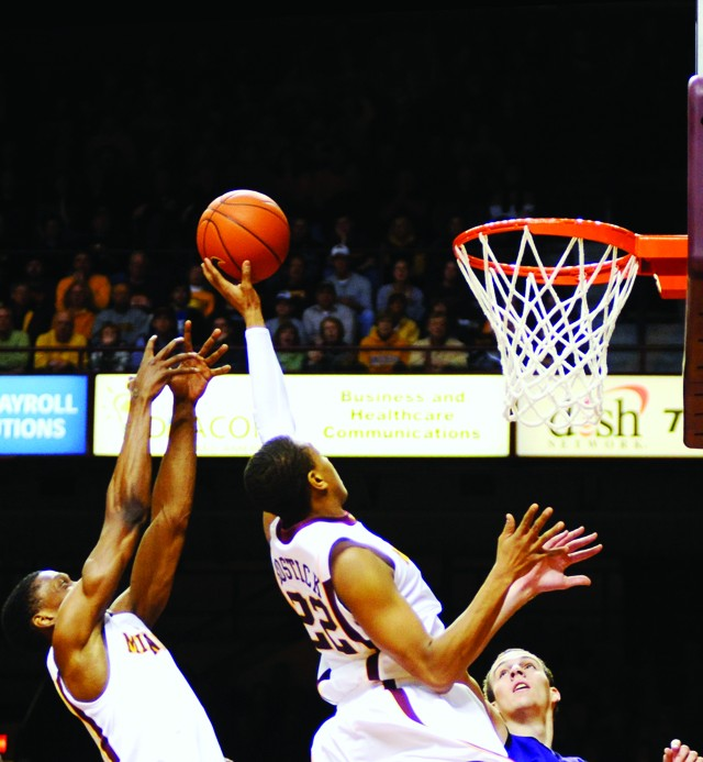 Juniors Devron Bostick (right) and Paul Carter both go up for the ball during Sunday's 72-45 win over Northwestern.