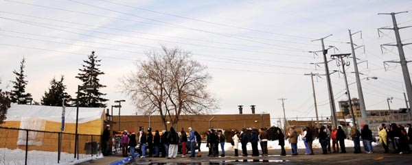 A line of people waiting to get their cars goes out the door at the Minneapolis Impound Lot on Monday.