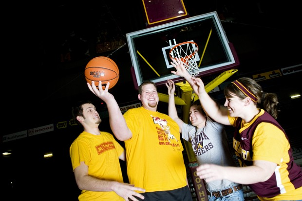 Members of the Barnyard, the official student group section of Williams Arena, Paul Dunfee, left, Luke Meyer, Woody Hanson, and Becca Picha.