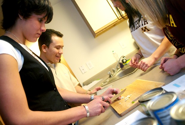 MBA students Pura Mendez, left, and Oscar Garzon worked with nutrition students to learn healthier cooking skills at the Melrose Apartments.