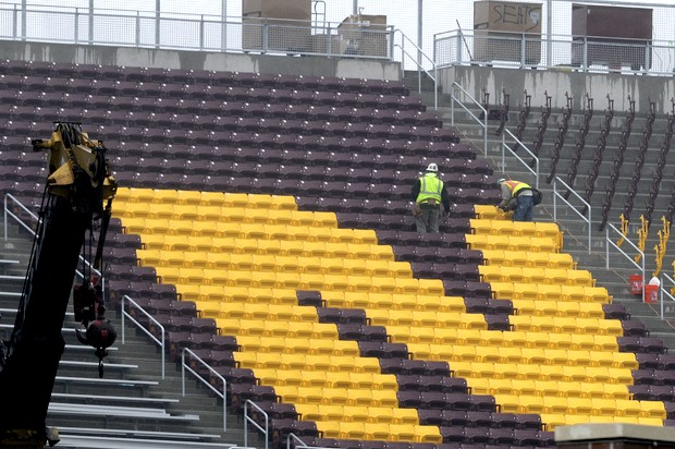 Construction workers install seats at the TCF Bank Stadium on Tuesday. Although the stadium's primary use will be Gopher football, it is possible that outdoor hockey, concerts and recreational sports could also use the stadium someday.