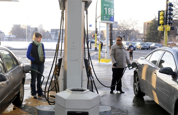 Senior Elementary Education Major Angela Bohrer fills her car up with gas last week at the BP gas station on the corner of 10th Avenue and University Avenue. According to Consumer Reports, the national gasoline average as of March 9 is $1.28 below the price this time last year.