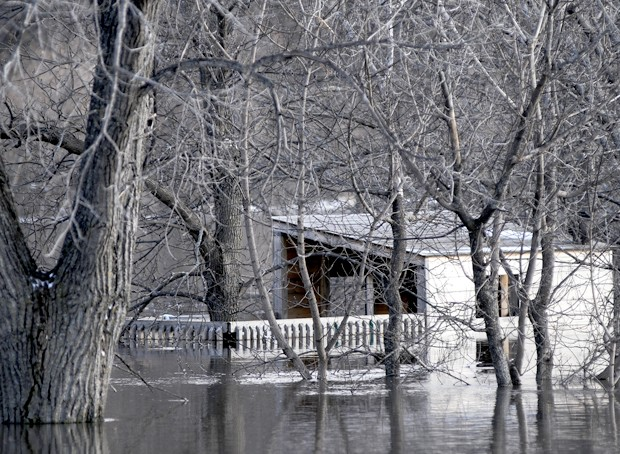 A structure that residents say was a tree house is now almost entirely underwater in a south Fargo neighborhood on Saturday.