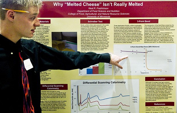 University food science first year Neal Fredrickson speaks about his cheese research at an undergraduate symposium held at the Coffman Memorial Union's Great Hall on Wednesday.
