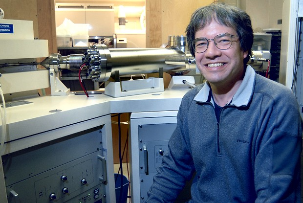 Larry Edwards, George and Orpha Gibson Chair of Earth Systems Science and Distinguished McKnight University Professor, recipient of a Guggenheim fellowship is pictured in front of a mass spectrometer used to determine the molecular composition of substances.