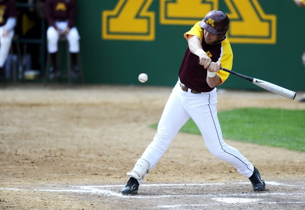 Sophomore Michael Kvasnicka puts a swing on the ball during Minnesota's monstrous 26-9 thrashing of Iowa at Siebert Stadium on Saturday afternoon. Kvasnicka went 3-for-6 with five RBIs in the game.