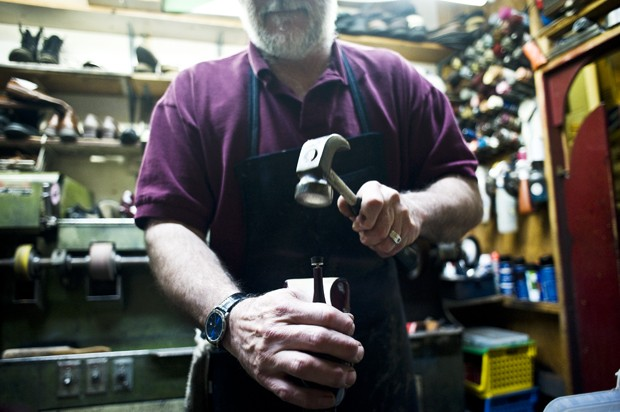 Jim Picard, owner of Fast Eddie's Shoe Repair, fixes a heel Friday at his shop. The store opened in 1971 and has been owned by Jim since 1985.