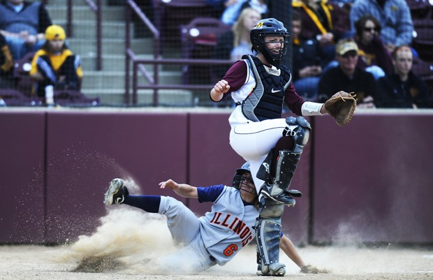 Catcher Shannon Stemper calls off a throw to the plate during Minnesota's loss to Illinois on Saturday as an Illini runner slides safely into home.
