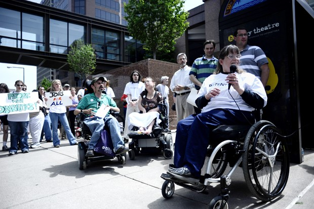 Kaposia employee and St. Paul College student Kari Sheldon speaks at a rally in St. Paul on Tuesday. The group wants construction employment goals to be created for those with disabilities.
