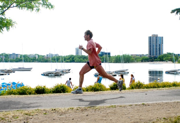 A runner jogs by Lake Calhoun in Uptown on Monday. Recent studies have shown that Minneapolis has been ranked high on the fitness scale, while others referred to the people of Minneapolis as 'little houses.'