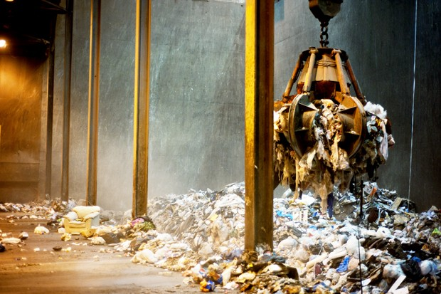 A crane carries trash into an incinerator at the Hennepin Energy Recovery Center on Monday. The center wants the city to allow them to increase burning by 200 tons per day.