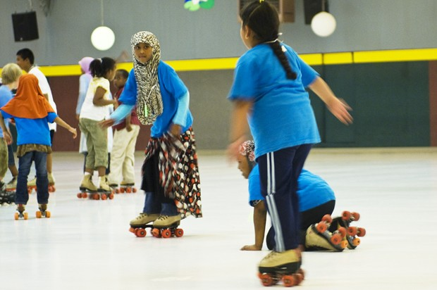 The Brian Coyle Community Center takes a field trip to the Roller Garden on Friday.