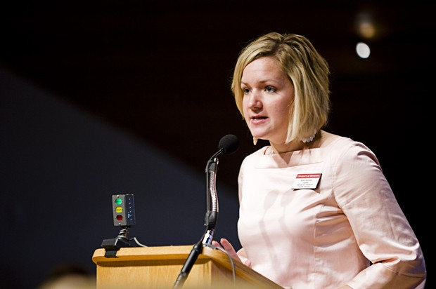 Kristi Kremers, president of the Graduate and Professional Student Assembly, speaks to the Board of Regents on budget issues Wednesday afternoon in the McNamara Alumni Center. Kremers spoke of the increasing debt burden that many students face with current tuition prices.